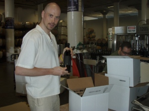 Boxing up the first bottles off the line